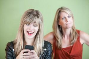 teen texting parent talking