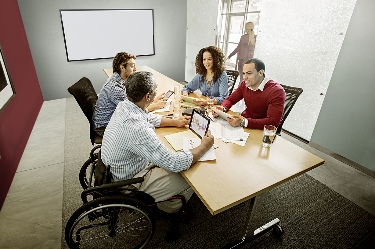 McAfee_business_3male1female_tablet_office_meeting_72dpi