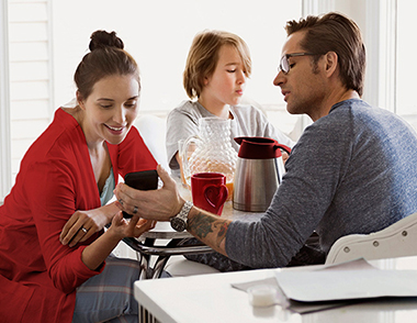family-at-table-smartphone-sm